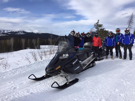 Media guests explore Big White Ski Resort by snowmobiles.